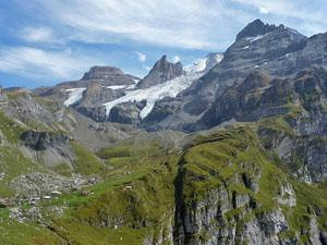 Looking back at Ober Bergli, the Bluemlisalp glacier and the pass